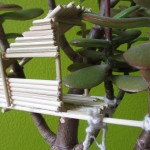 Miniature tree house in potted plant