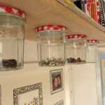 Hanging jars under a bookshelf