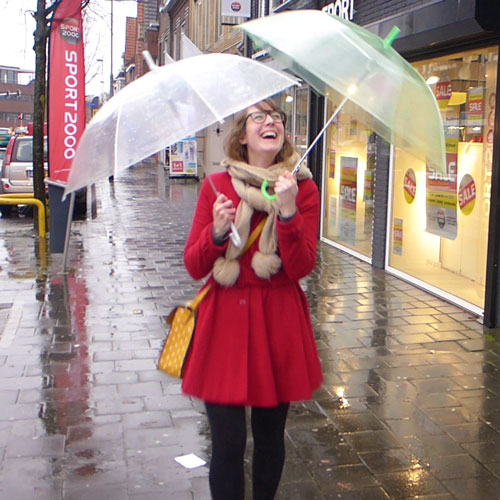 Give away umbrellas to strangers in the rain