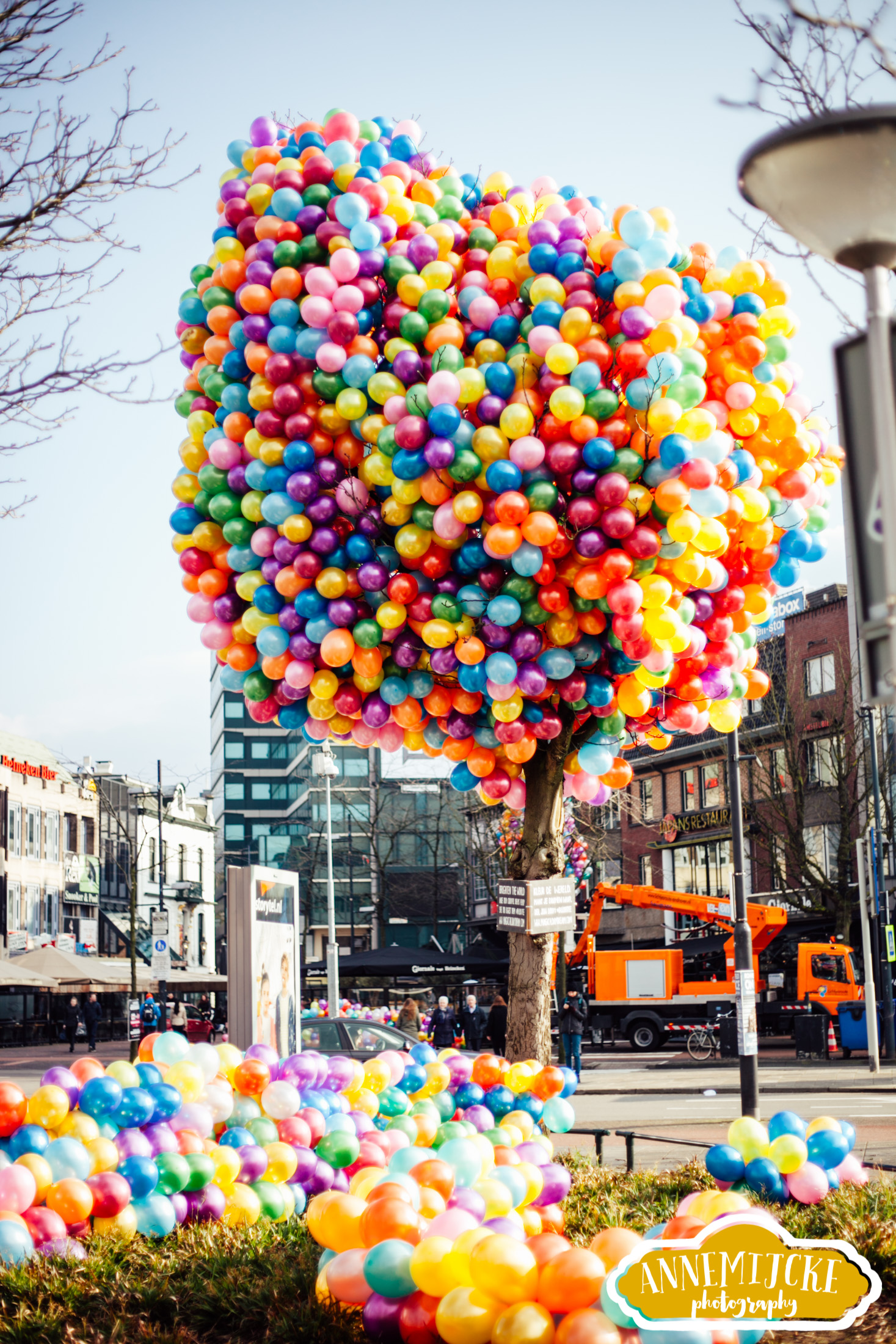 Balloon tree by Mariëlle Coppes from Magical Daydream at Eindhoven Central Station in The Netherlands | I created a balloon tree with the help of an aerial platform, 25 volunteers and 6000 balloons. The tree is a colourful street art installation that makes people smile, and the many balloons remind of the movie 'Up' by Pixar. Click to see many more happy pictures of the street art project.
