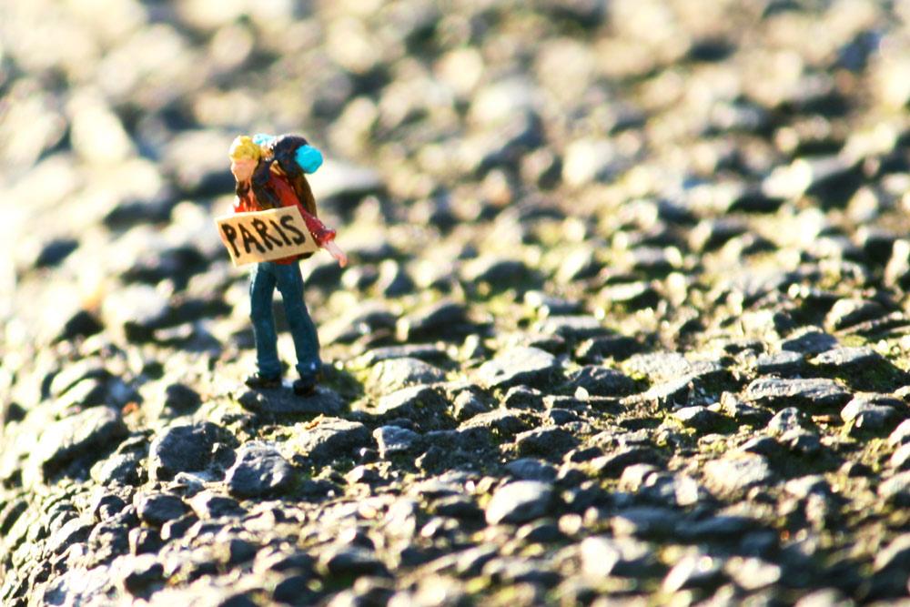 minature street art hitchhiker